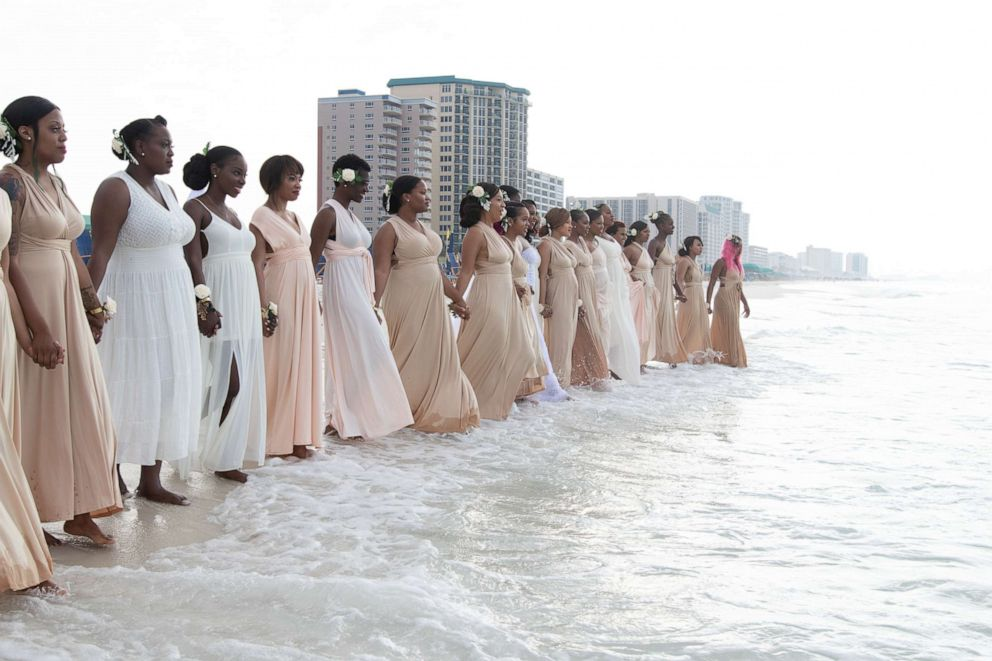 Casme Carter said having 34 bridesmaids went smoothly and that they supported her during some tense times at her Florida wedding.