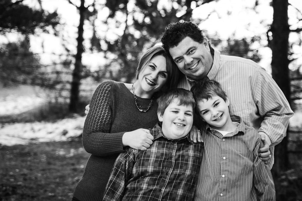 Carlyn McClelland with her husband, Paul, and their two sons.