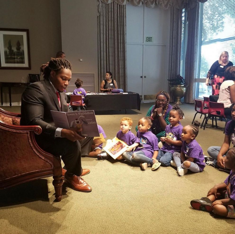 PHOTO: Caylin Moore reading to kids