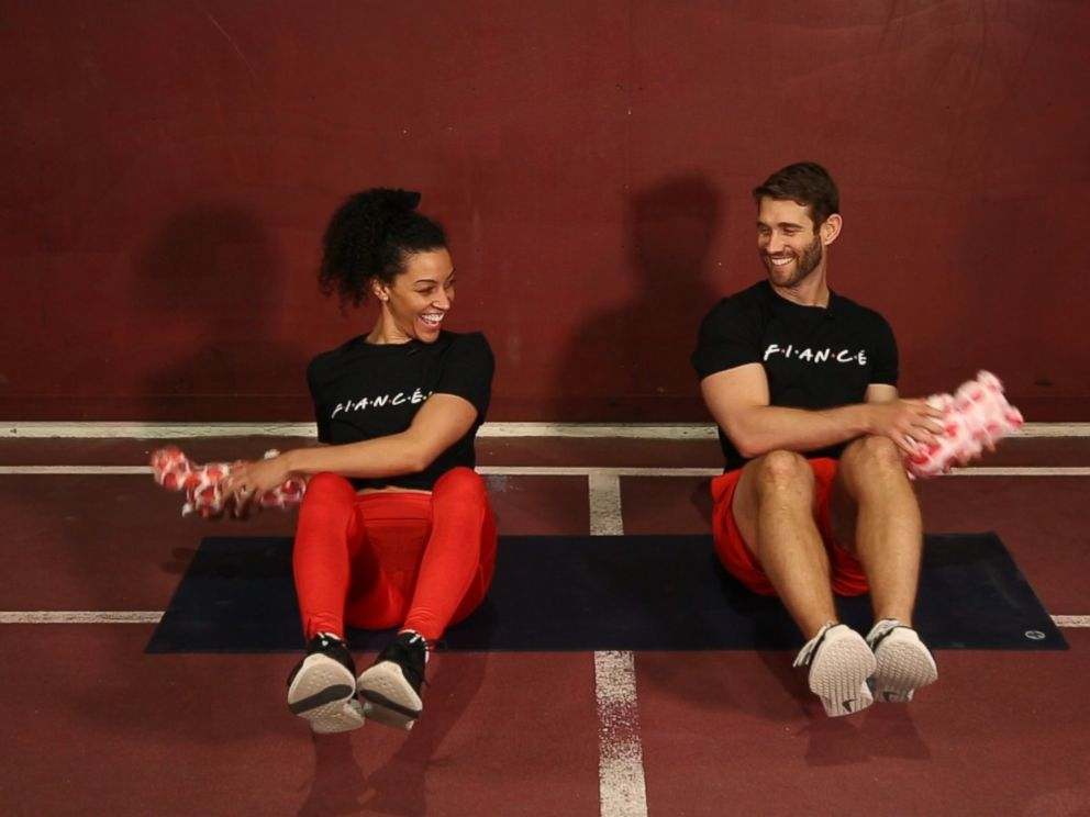 PHOTO: Engaged trainers Bree Branker and CJ Koegel demonstrate a couples workout at Chelsea Piers in New York City.