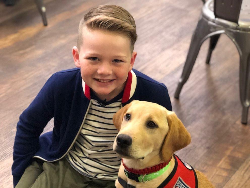 PHOTO: Eli, who has type 1 diabetes, poses with his new diabetes alert dog.