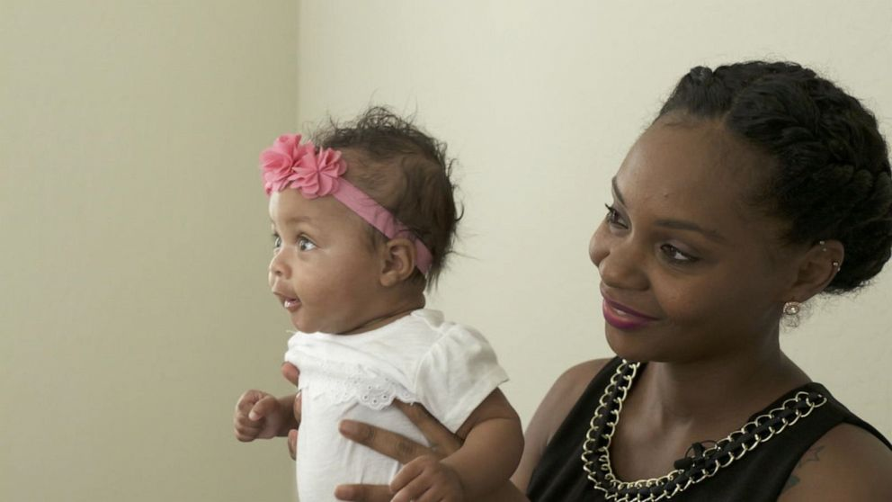 PHOTO: Candace Farris holds her daughter Victory.