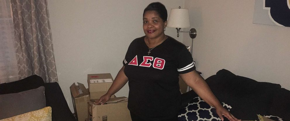 PHOTO: Michelle Lindsey poses with school supplies donated by members of Delta Sigma Theta Sorority.