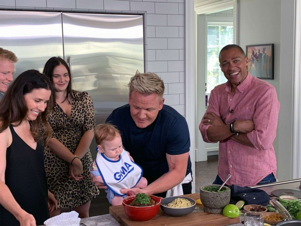 PHOTO: Chef Gordon Ramsay holds his son Oscar, alongside his wife Tana, in his kitchen after preparing a Moroccan-inspired dish.