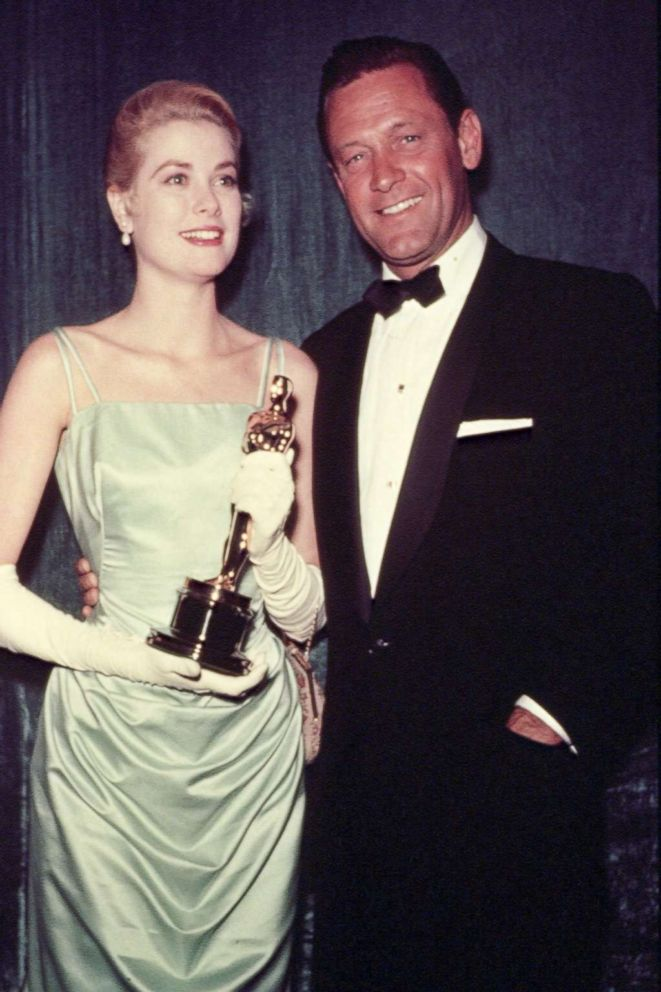 PHOTO: Grace Kelly and William Holden attend the 27th Academy Awards ceremony.
