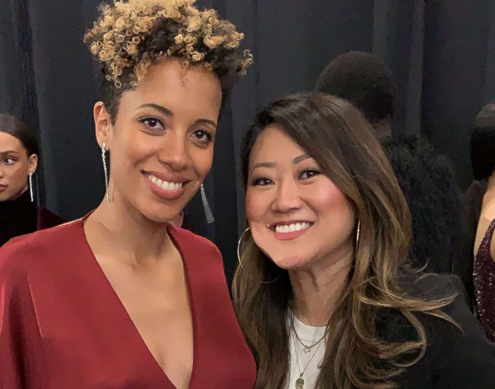 Grace Lee posing with designer Carly Cushnie after the fall 2019 Cushnie show.