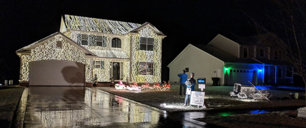 "PHOTO: Greg Osterland of Wadsworth, Ohio, says he uses 25,000 lights to decorate his house each year, just like the film, ""National Lampoons Christmas Vacation."""