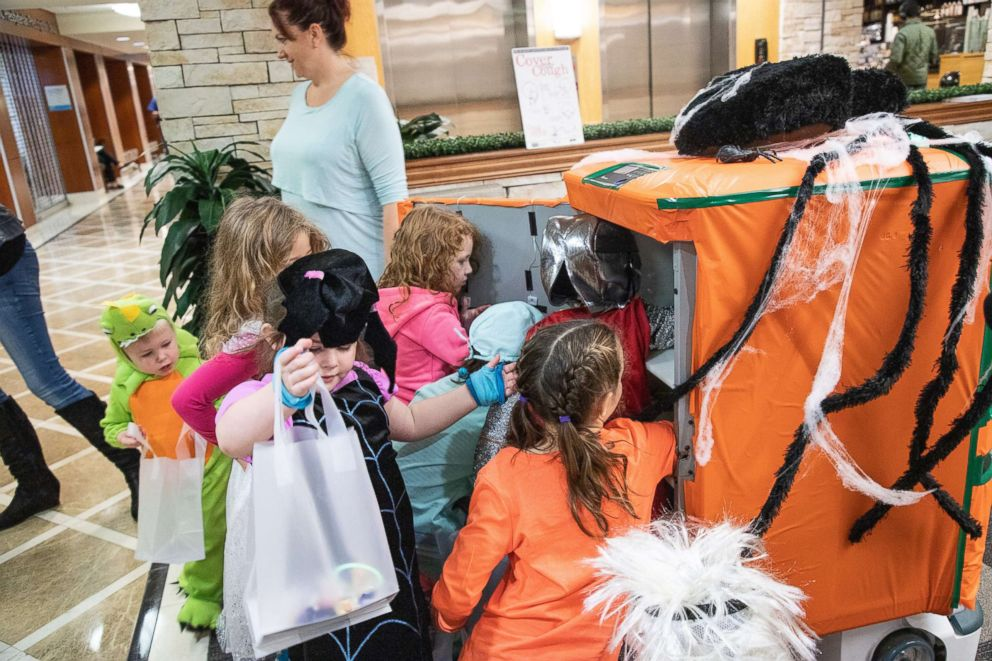 Halloween robots bring joy to patients and their families at