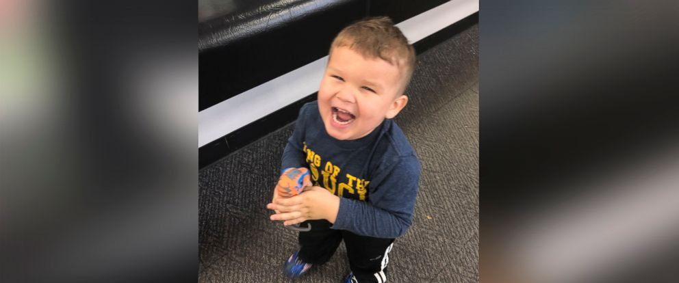 """PHOTO: 3-year-old Jordan reunited with his """"fixed"""" dinosaur after Best Buy employee performed """"surgery"""" on his favorite toy."""