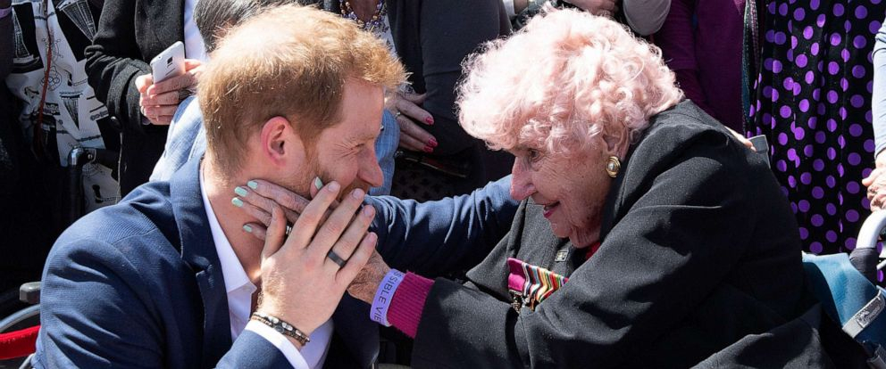 PHOTO: Prince Harry is embraced by 98-year-old Daphne Dunne outside of the Opera House in Sydney, Australia, Oct. 16, 2018.