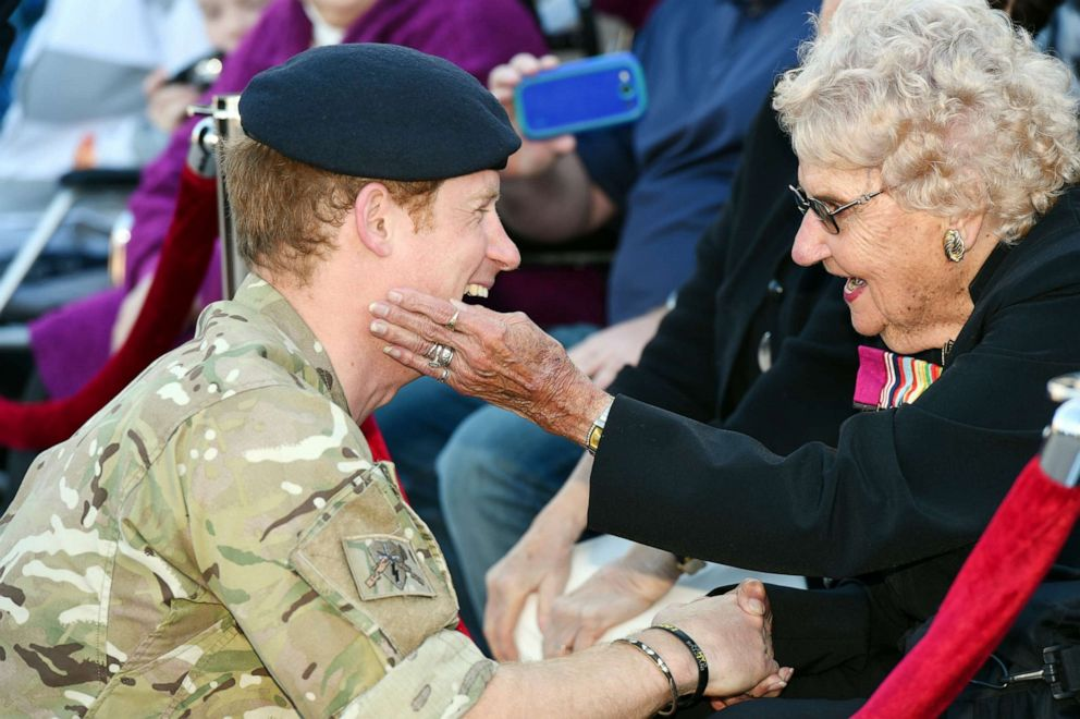 PHOTO: Prince Harry talks with Australian war veteran Daphne Dunne during a visit to the Sydney Opera House in Sydney, Australia, May 7, 2015.