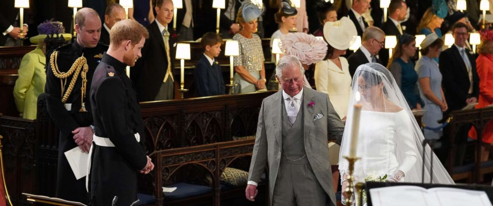 PHOTO: Britains Prince Harry looks at his bride, Meghan Markle, as she arrives accompanied by the Britains Prince Charles in St Georges Chapel during their wedding ceremony in St Georges Chapel, Windsor Castle, in Windsor, May 19, 2018.