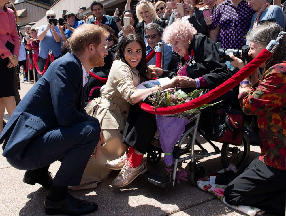 PHOTO: Prince Harry, Duke of Sussex and Meghan, Duchess of Sussex meet 98 year old Daphne Dunne during a meet and greet at the Sydney Opera House, Oct. 16, 2018, in Sydney.