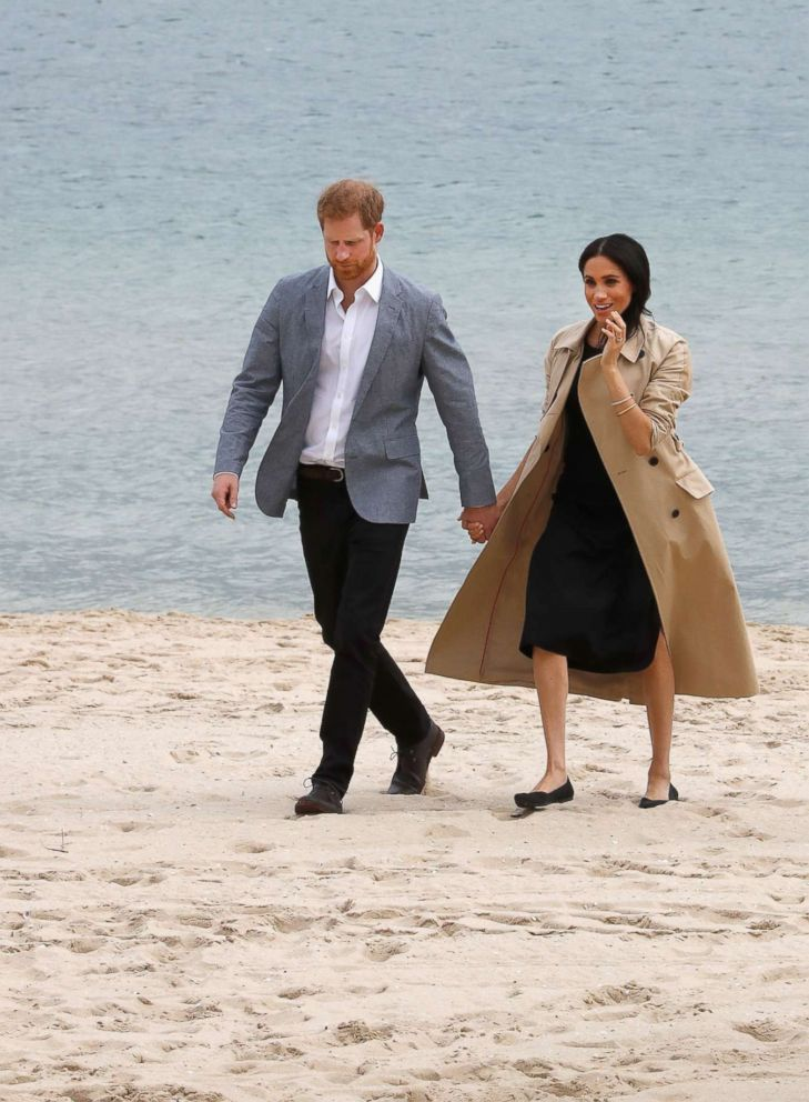 Prince Harry, Duke of Sussex and Meghan Markle, Duchess of Sussex attend a beach cleanup on South Melbourne Beach, Oct. 18, 2018, in Melbourne, Australia.