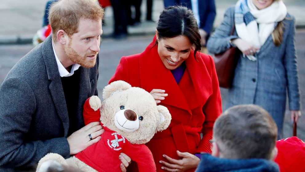 Britain's Prince Harry and Meghan Markle, Duchess of Sussex receive a teddy bear as they visit the Hamilton Square in Birkenhead, Britain, Jan. 14, 2019.