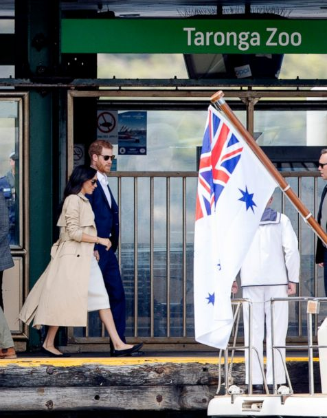 Meghan Markle and Prince Harry play with koalas on 1st day