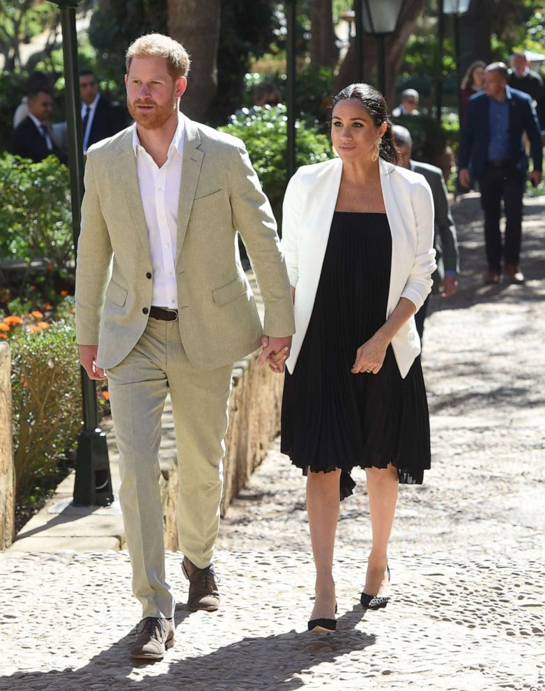 Prince Harry, Duke of Sussex and Meghan, Duchess of Sussex walk through the walled public Andalusian Gardens which has exotic plants, flowers and fruit trees during a visit, Feb. 25, 2019, in Rabat, Morocco.