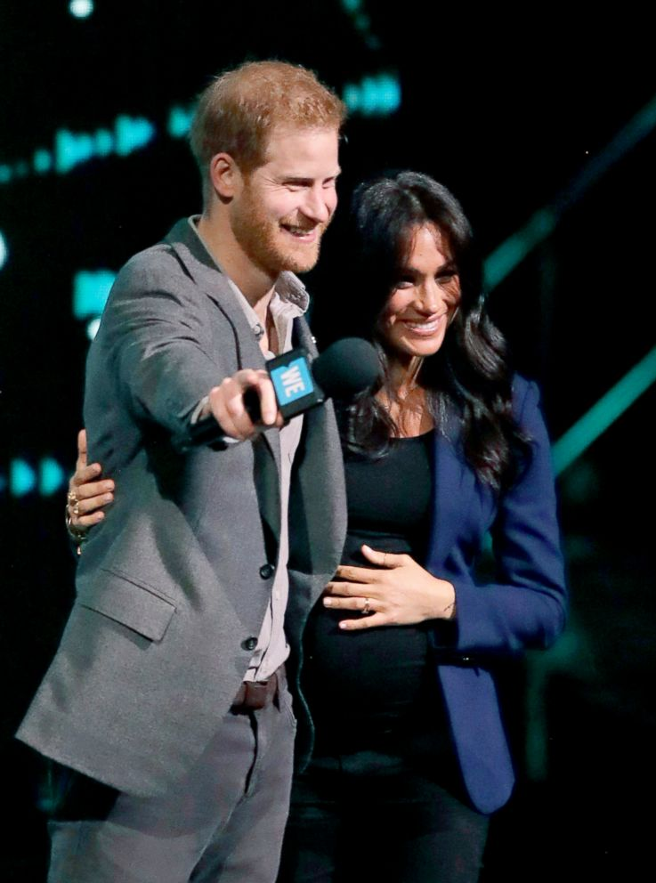 PHOTO: Meghan the Duchess of Sussex, is brought on stage by Britains Prince Harry during his speech at WE Day UK, a global initiative to encourage young people to take part in positive social change at the SSE Arena in Wembley, London, March 6, 2019.