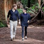Britain's Prince Harry and Meghan Markle, Duchess of Sussex walk through a Redwoods forest in Rotorua, New Zealand, Oct. 31, 2018.