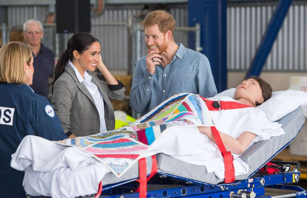 PHOTO: Meghan Markle, Duchess of Sussex and Prince Harry, Duke of Sussex look at medical training equipment, during a naming and unveiling ceremony for the new Royal Flying Doctor Service aircraft at Dubbo Airport, Oct. 17, 2018, in Dubbo, Australia.