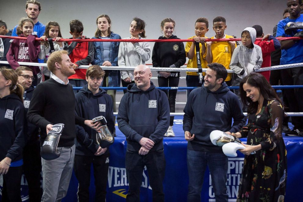 PHOTO: Britains Prince Harry, Duke of Sussex and Meghan, Duchess of Sussex are presented with boxing gloves during a visit the Boxing Charity, Empire Fighting Chance, in the Easton area of Bristol, Britain Feb. 1, 2019.