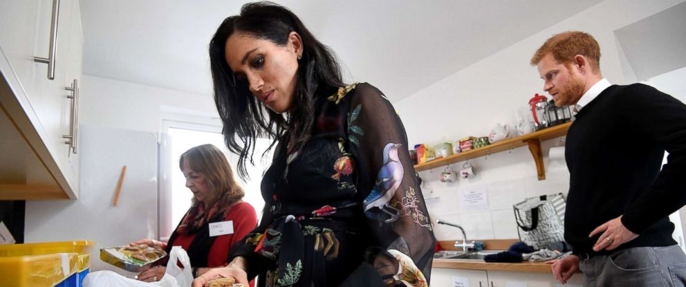 PHOTO: Britains Meghan, Duchess of Sussex helps volunteers in the kitchen as they pack food parcels to go in the charity outreach van during a visit to One25 charity in Bristol, south west England, Feb. 1, 2019.