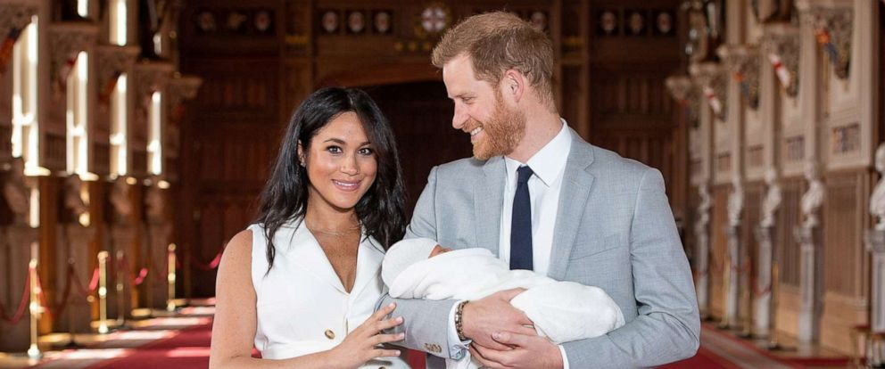 PHOTO:Britains Prince Harry and Meghan, Duchess of Sussex, hold their newborn baby son in St Georges Hall at Windsor Castle, in Windsor, England, May 8, 2019.