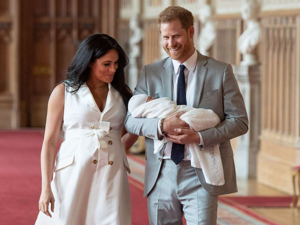 PHOTO: Britains Prince Harry, Duke of Sussex and his wife Meghan, Duchess of Sussex, carry their newborn baby son in St Georges Hall at Windsor Castle in Windsor, England, May 8, 2019.