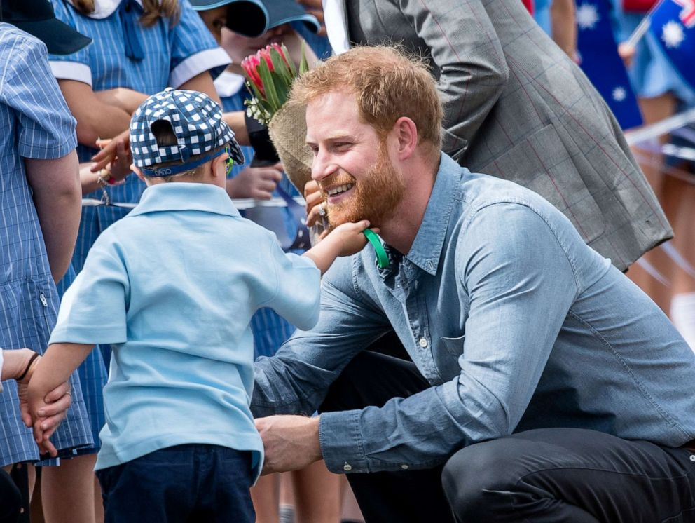 PHOTO: Prince Harry, Duke of Sussex is greeted by five-year-old Luke Vincent as they arrive at Dubbo Airport, Oct. 17, 2018, in Dubbo, Australia.