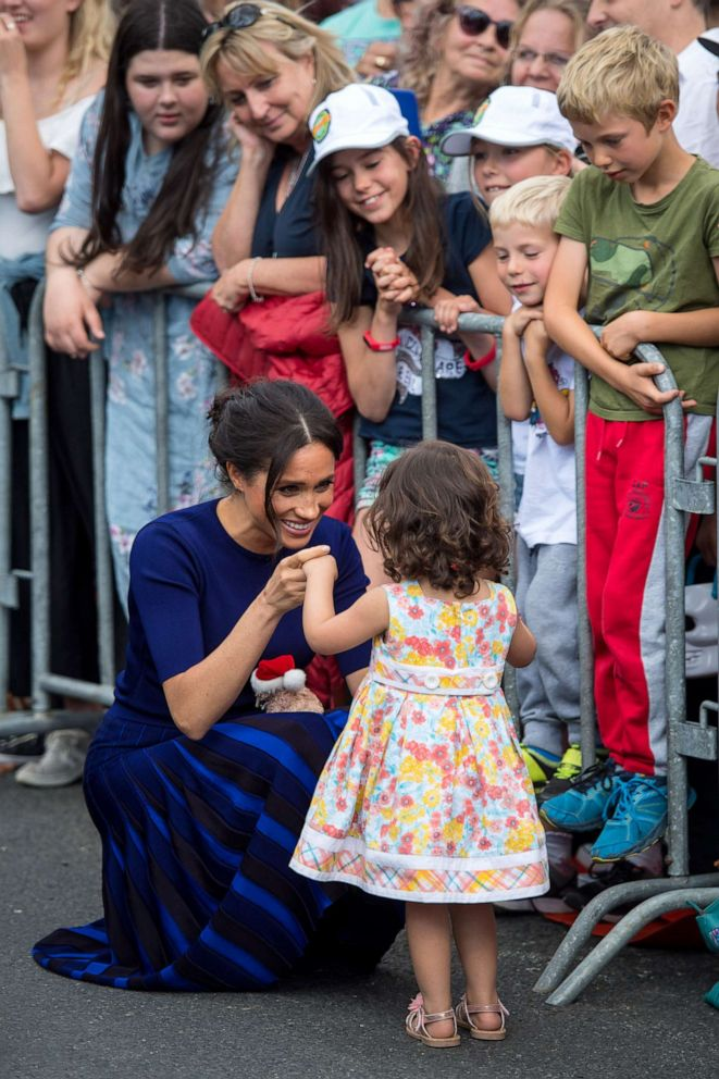 PHOTO: Megan, Duchess of Sussex holds hands with a young girl during a walkabout on day four of the royal couples tour of New Zealand, Oct. 31, 2018, in Rotorua, New Zealand.