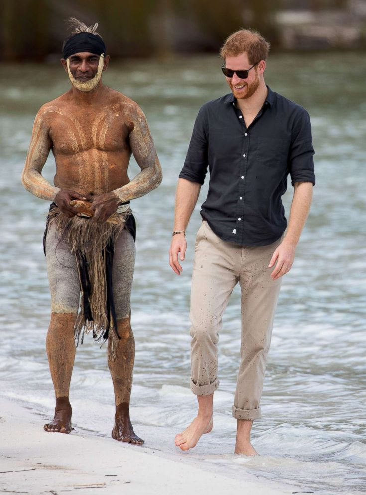 PHOTO: Prince Harry, The Duke of Sussex talks to aboriginal Song Man Aaron Henderson on the shore of Lake McKenzie on Fraser Island, Australia, Oct. 22, 2018.