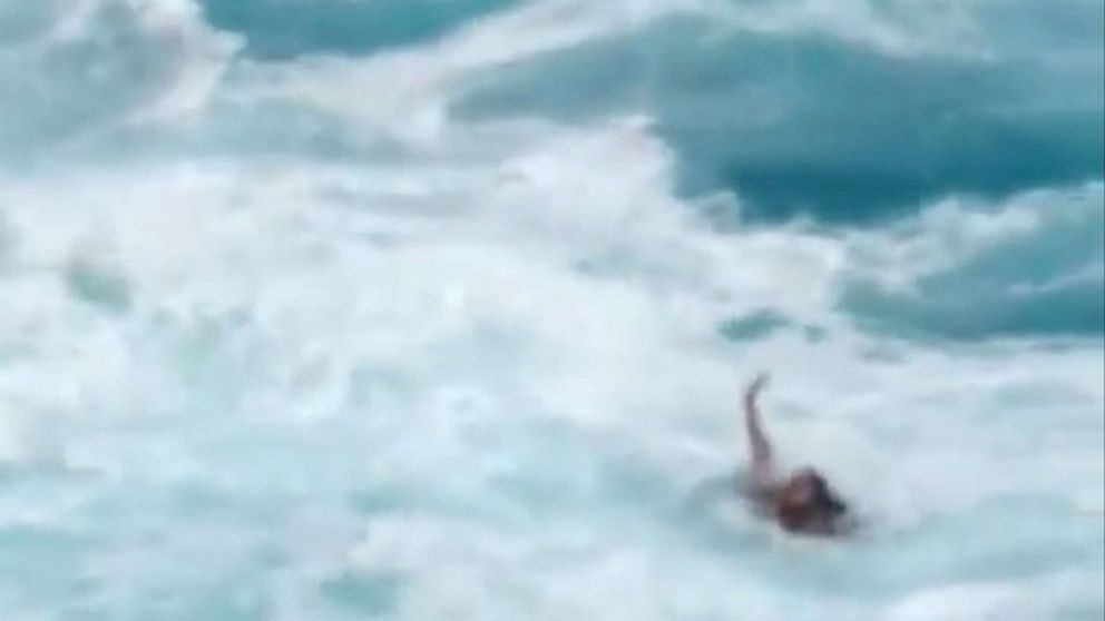 Rescue of couple who slipped off Hawaiian cliff into ocean