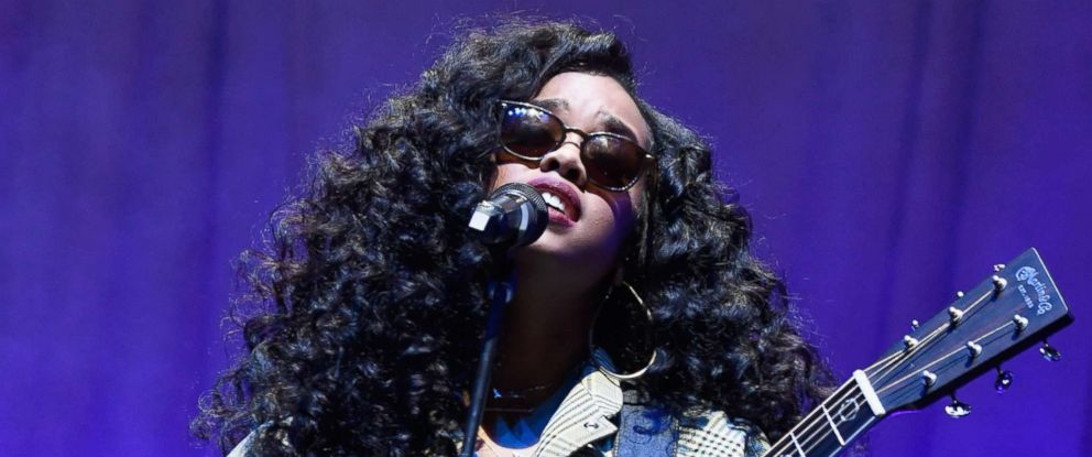 """PHOTO: H.E.R. performs onstage during the Spotify """"Best New Artist 2019"""" party, Feb. 7, 2019, in Los Angeles."""
