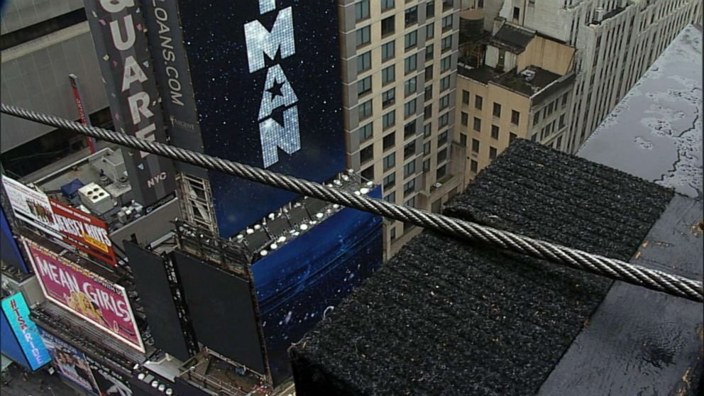 PHOTO: Acrobat siblings Nik and Lijana Wallenda prepare to attempt a highwire stunt in the middle of Times Square in New York City.