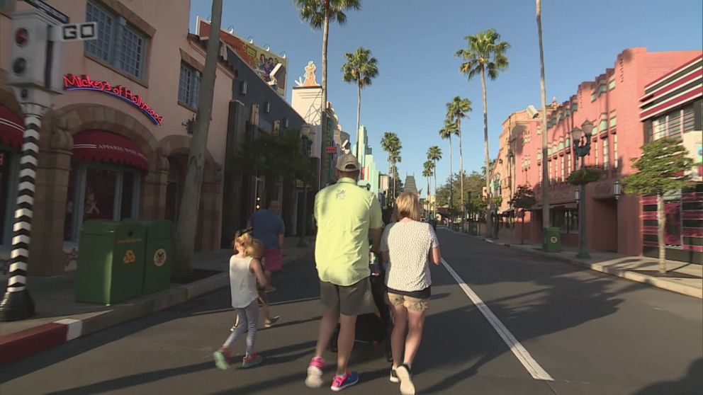 PHOTO: A family walks down Hollywood Boulevard at Disneys Hollywood Studios.