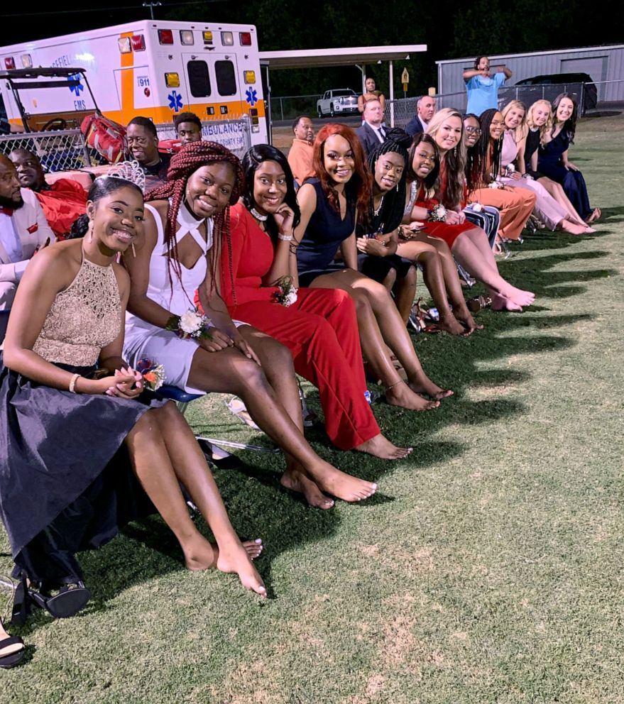 PHOTO: Twelve homecoming court candidates who walked barefoot across a football field in South Carolina in solidarity with their classmate.