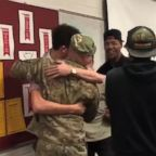 Captain Andrew Olson is greeted by his student athletes when he surprised them at school.