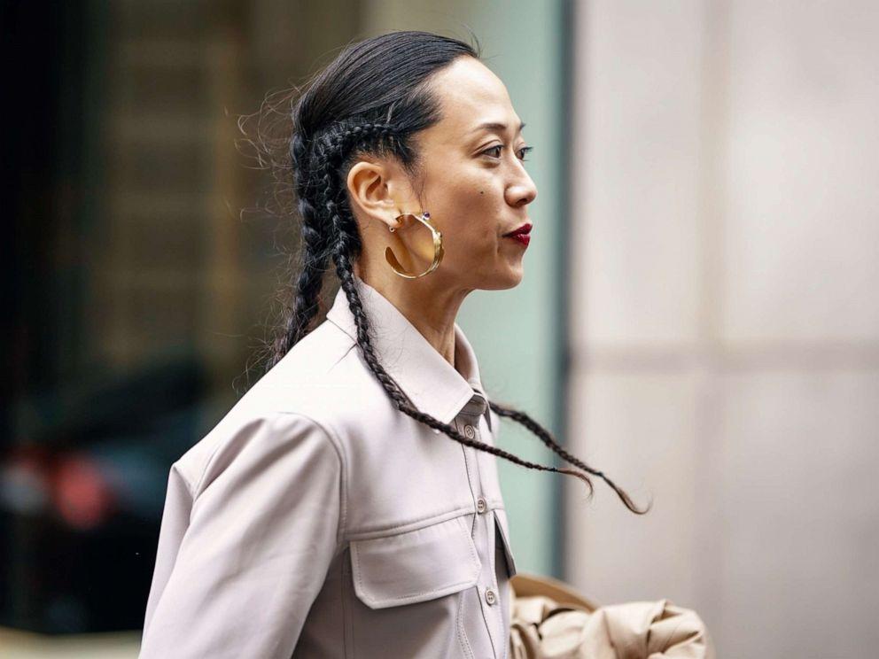 PHOTO: A guest wears earrings, a grey shirt, outside Thom Browne, during Paris Fashion Week Womenswear Fall/Winter 2019/2020, March 3, 2019 in Paris.