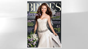 PHOTO A wedding dress designed by Vanessa Tapia is shown on the Dec. cover of Brides Magazine.