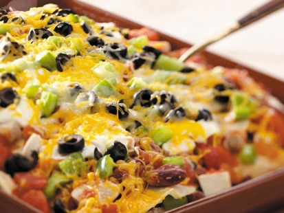 PHOTO This recipe for corn tortilla chicken lasagna serves 24, satisfying a hungry crowd.