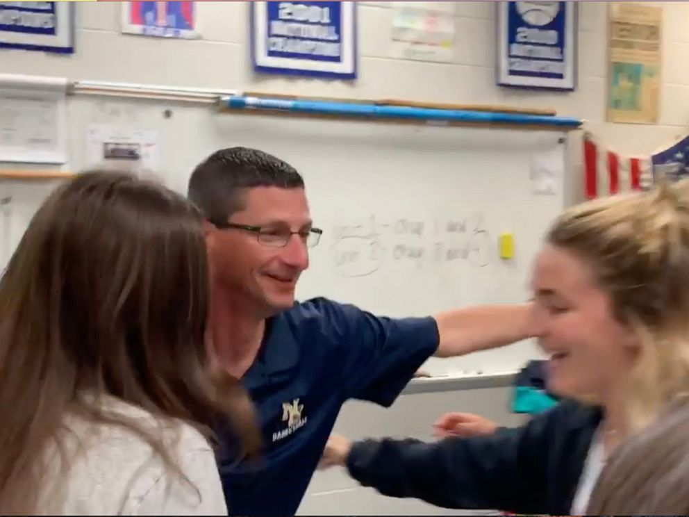 PHOTO: New Egypt High School history teacher Tom Corby hugs his students after they surprised him with tickets to see Hamilton.