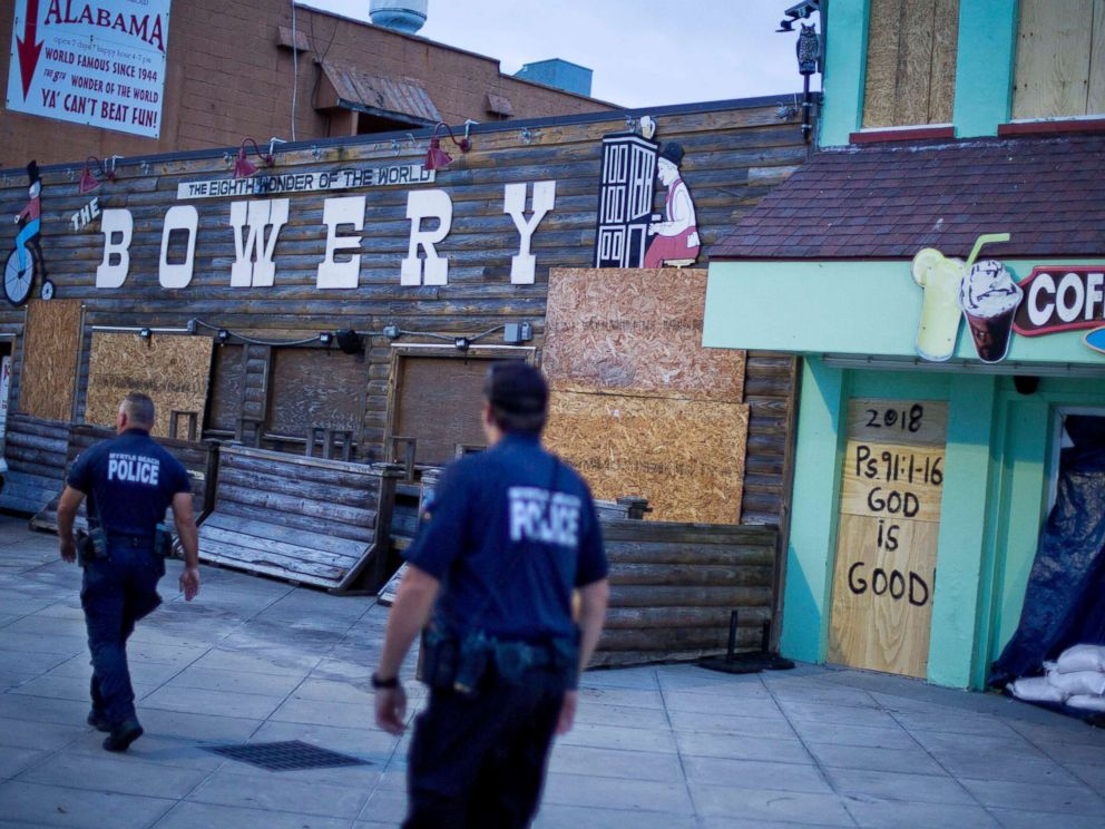 PHOTO: Police patrol past boarded up shops along the boardwalk in Myrtle Beach, S.C., Thursday, Sept. 13, 2018, as Hurricane Florence approaches the east coast.