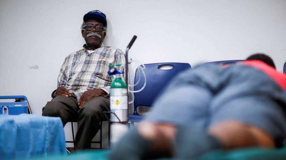 A man attached to a respiratory machine sits in a shelter run by Red Cross before Hurricane Florence comes ashore in Grantsboro, N.C., Sept. 13, 2018.