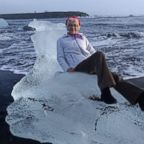 Judith Streng posed seated on an iceberg while her son Rod Streng took a picture before a wave pulled her out and prompted a rescue.
