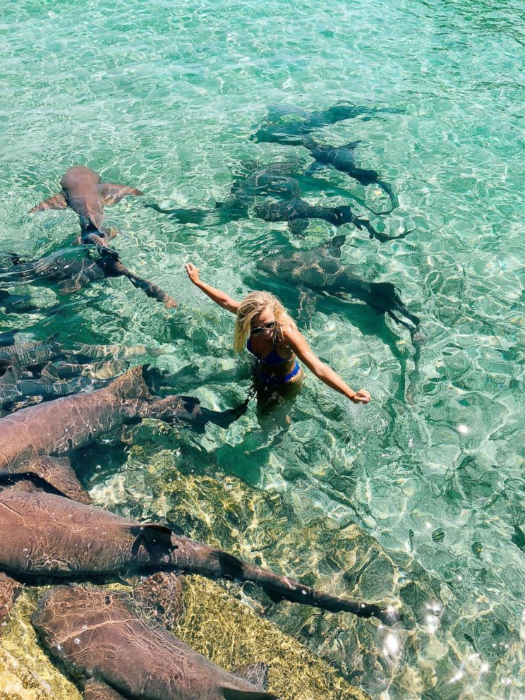 PHOTO: Instagram model Katarina Zarutskie stands alongside nurse sharks in the Bahamas.