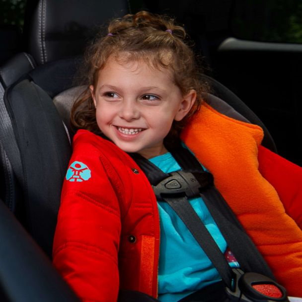 3746fc079b06 Mom of 3 creates a car seat-friendly coat for kids
