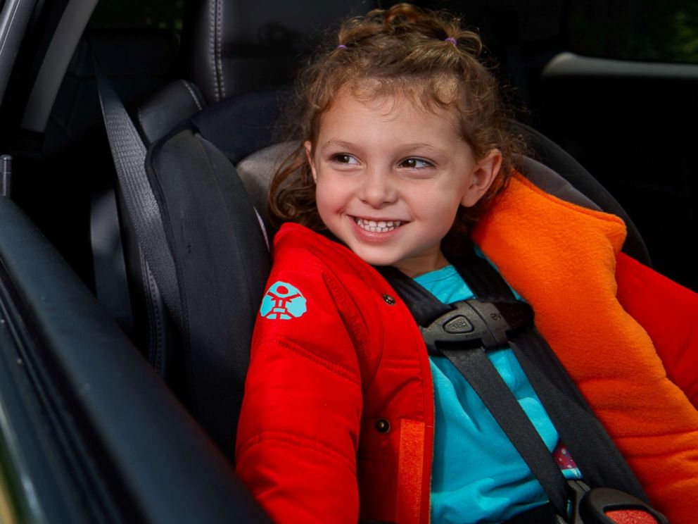 PHOTO: A Buckle Me Baby Coats coat opens so the car seat harness is not blocked by fabric.