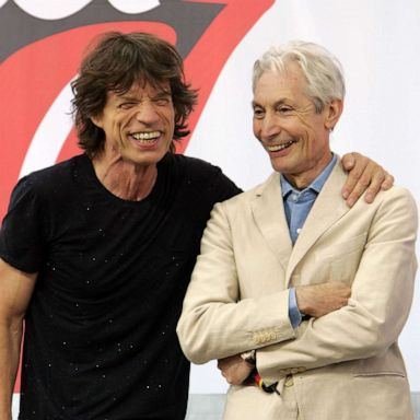 PHOTO: Mick Jagger, left, and Charlie Watts of The Rolling Stones talk to reporters during a press conference to announce a world tour at the Julliard Music School May 10, 2005, in New York City.