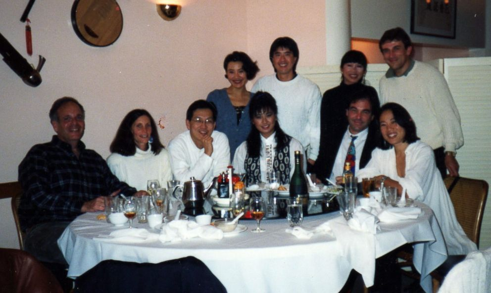 Janet Yang, seated on the far right, is pictured at a celebratory dinner in San Francisco with Oliver Stone, Amy Tan and Joan Chen among others.