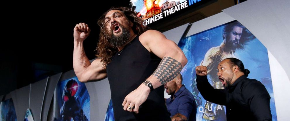 """PHOTO: Jason Momoa performs a haka dance at the premiere for """"Aquaman"""" in Los Angeles, Dec. 12, 2018."""